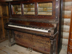 38. Cremona style 3 coin piano #121,649, made in 1912; N.C. Music Hall. Charlie Bovey�s first coin piano.
