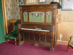 Cremona style G coin piano #10,836 with flute pipes, made in 1914; V.C. Opera House lobby.